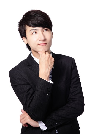asian man face: Handsome young business man think looking up to empty copy space