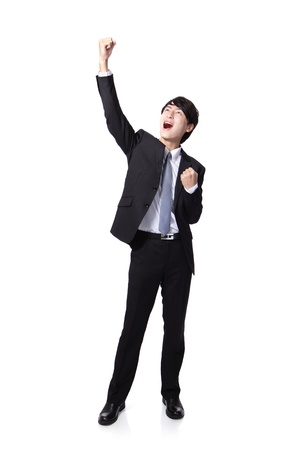 to raise: Excited handsome business man with arms raised in success in full length Isolated on white background, mode is a asian people Stock Photo