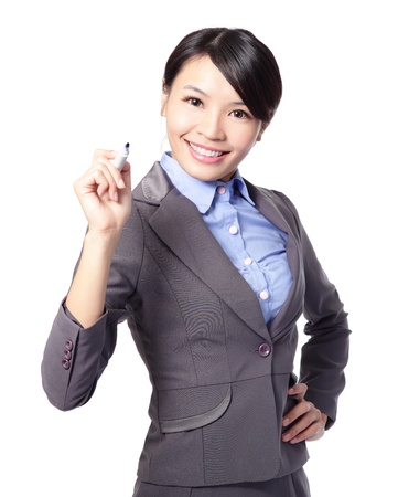 young add: Young beautiful business woman with pen writing something in the air isolated on white background. Focus on blue maker pen. great for you add stock graph, asian woman model