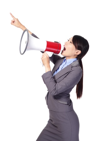 woman screaming: Business woman screaming with a megaphone and finger point to empty copy space isolated on white background, model is a asian beauty