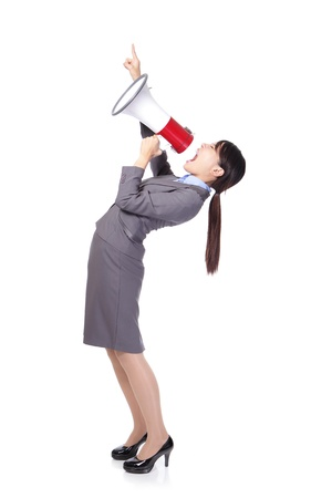 woman shouting: Business woman screaming with a megaphone and finger point to up forward copy space in full length isolated on white background, model is a asian beauty