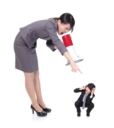 big angry boss (business woman) with megaphone yelling to small Staff (business man) , isolated on white background, asian model photo
