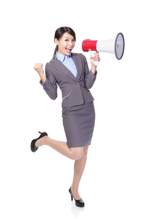 Business woman happy with a megaphone and hand show win gesture in full length isolated on white background, model is a asian beauty photo