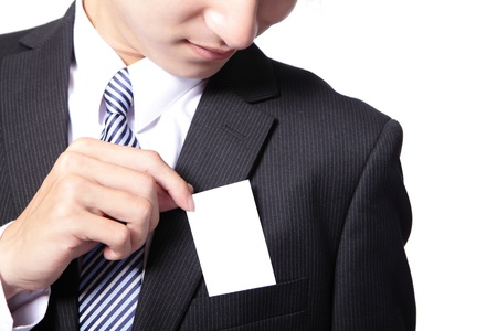 Close up of business card in business man suit pocket (great for copy space) - horizontal , asian male model photo