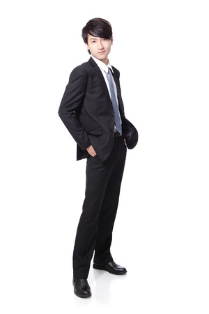 Portrait of a young handsome businessman standing isolated over white background, mode is a asian male Stock Photo - 16949403