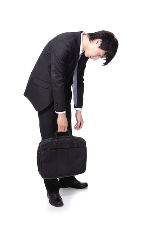 Portrait of a young business man looking depressed from work in full length isolated over white background, asian male model photo