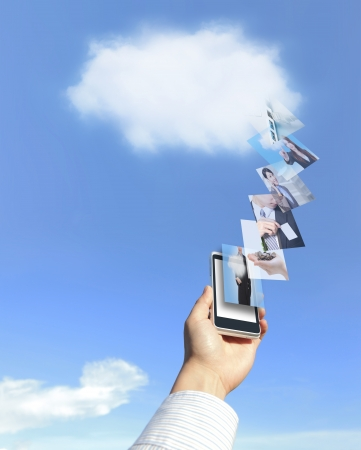 hand holding mobile phone with cloud computing Stock Photo - 16949407