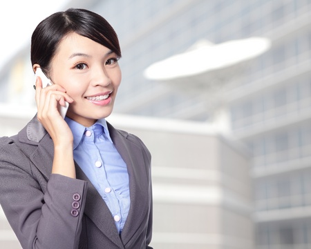close up of Beautiful smiling business woman talking on the mobile phone at office, asian beauty model photo