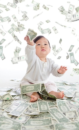baby catch money rain in the air isolated on a white background, concept for business, asian girl baby child photo