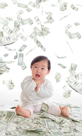 baby surprised funny face with money rain in the air isolated on a white background, concept for business, asian girl baby child Stock Photo - 16987950