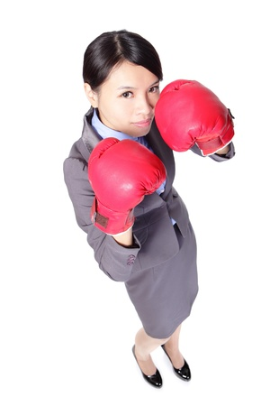 Confident modern business woman with boxing gloves in full length isolated over white background, high angle view, asian beauty model photo