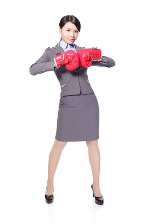 Confident modern business woman with boxing gloves in full length isolated over white background, asian beauty model photo