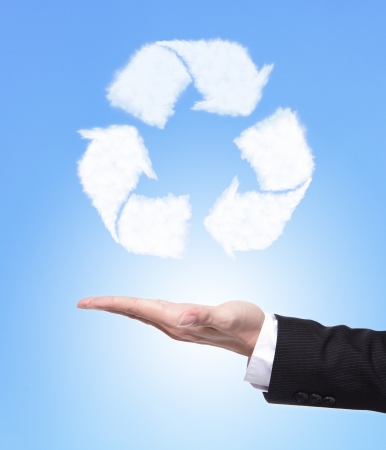 recycle sign ( by cloud ) with blue sky and business man hand holding it, eco concept photo