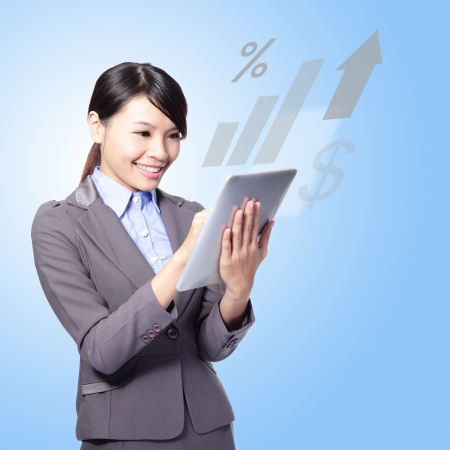Portrait of happy business woman with tablet pc computer - finance sign from the screen. Online commerce concept, asian beauty model photo