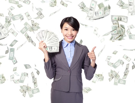 giving money: business woman with handful of money giving thumbs up with money rain, asian beauty model