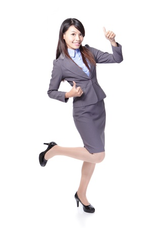 Happy smiling business woman with thumbs up gesture in full length isolated on white background, model is a asian beauty photo