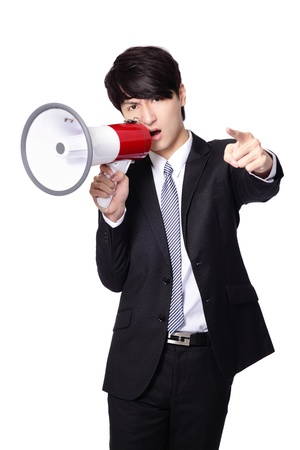 loudly: Business man angry screaming loudly in a megaphone isolated on white background, model is a asian male