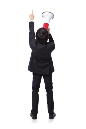 back view of Young business man shouting into a megaphone and finger point to up forward in full length isolated over a white background, asian model photo