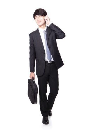 Business man happy Walking and speaking mobile phone in full length isolated over white background, asian model