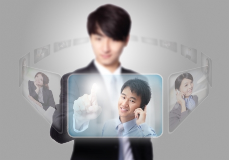 Human Resources concept, business man hand finger choosing perfect employees options by touch button photo