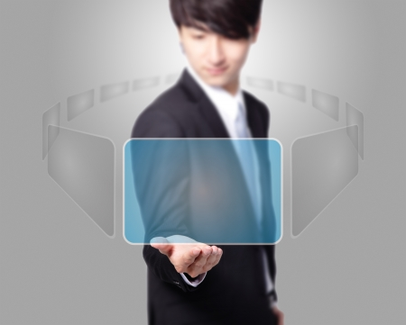 Business man holding a touch screen ( choosing from many virtual screen ) with empty copy space on gray background, asian model Stock Photo - 17058003