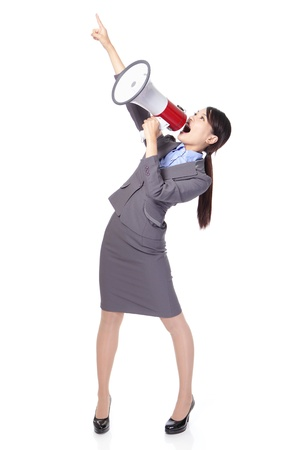 Business woman with megaphone yelling and finger pointing to empty copy space isolated on white background, asian model photo