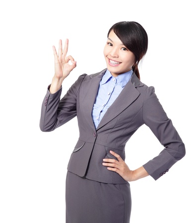 okay sign: Perfect - business woman showing OK hand sign smiling happy. Young pretty Asian businesswoman isolated on white background. Stock Photo