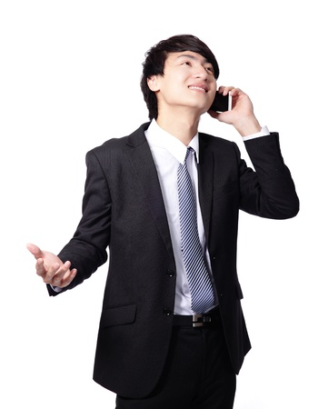happy handsome young business man using mobile phone isolated on white background, model is a asian male photo