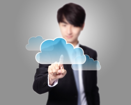 download link: futuristic display: Cloud computing touchscreen interface, business man finger touch cloud with gray background, asian model Stock Photo
