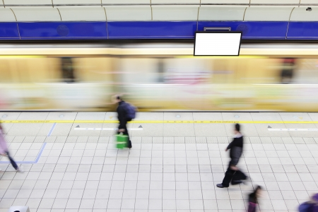 people walking on platform at a metro railway station with motion blur speed train and blank tv billboard Stock Photo - 17188624