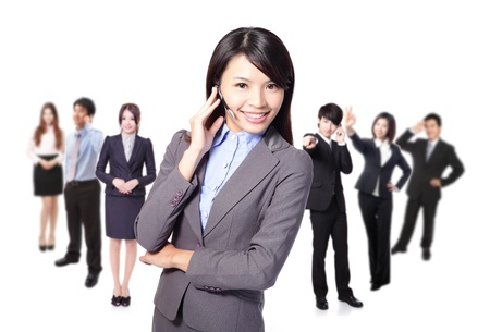 Smiling call center executive with colleagues in blur background isolated on white background Stock Photo - 17191150