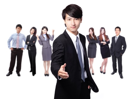 chinese businessman: Handsome young business man happy smile shake hand over group of business people background Stock Photo