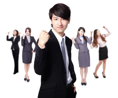 team victory: Successful excited Business man smile hold fist with young business people group team isolated over white background