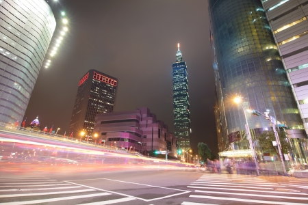 Colorful city night scene with cars motion blurred with skyscrapers in Taipei, Taiwan. Stock Photo - 17187235