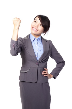 Happy Success winner business woman celebrating with her arms up and show fist isolated over a white background photo