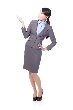 Smiling business woman presenting in full length Isolated over white background photo