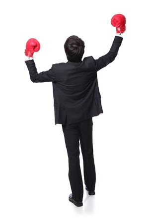 back view of young handsome Businessman win pose with boxing gloves and raise his arms in full length isolated on white background, asian model photo