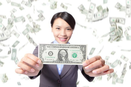 business woman smile show money with falling money rain background, asian beauty model photo