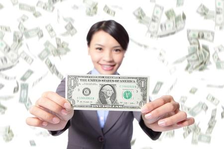 money rain: business woman smile show money with falling money rain background, asian beauty model Stock Photo