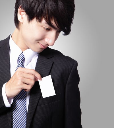 namecard: business card in business man suit pocket (great for copy space) with gray background, asian male model