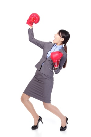 winning business woman: Winner and business success concept - Winning business woman celebrating wearing boxing gloves in full length isolated on white background. Young Asian female model.