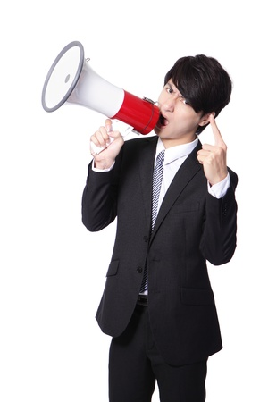 power point: Business man screaming loudly in a megaphone isolated on white background, model is a asian male