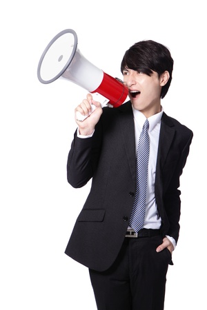 loudly: Business man screaming loudly in a megaphone isolated on white background, model is a asian male