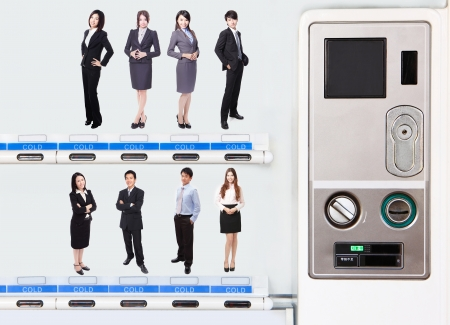 vending machine: Human Resources concept: choosing the perfect candidate for the job by their price in vending machine, model are asian people Stock Photo