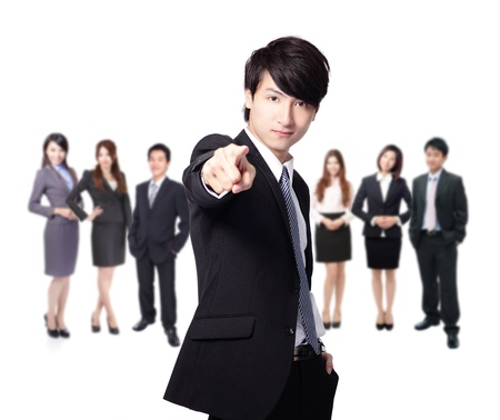 business man finger pointing at you, leading a business team group isolated on white background, asian model photo