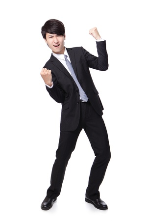 energetic people: Excited handsome business man with arms raised in success in full length Isolated on white background, mode is a asian people Stock Photo