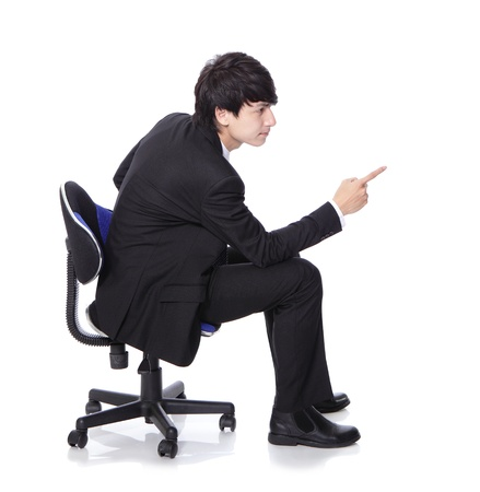 profile view: businessman sit on chair and hand finger point to empty copy space, concept of advertisement product isolated over white background, asian model Stock Photo