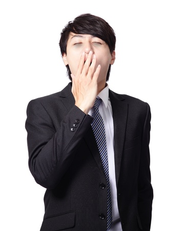 overworked business man yawning with black rim of eye isolated on white background, model is a asian people photo