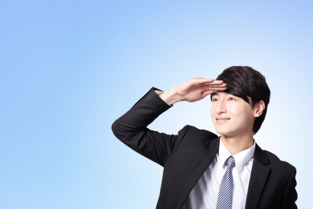 Successful handsome business man purposefully looking away to empty copy space isolated on blue background, mode is a asian male Stock Photo - 17447101
