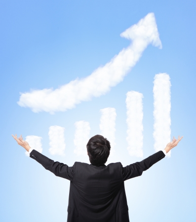 I want be rich - back view of Business man hug a growth graph ( made by cloud ) in the air with blue sky, finance and business concept, asian model photo